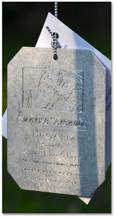 An engraved Grace note sail.